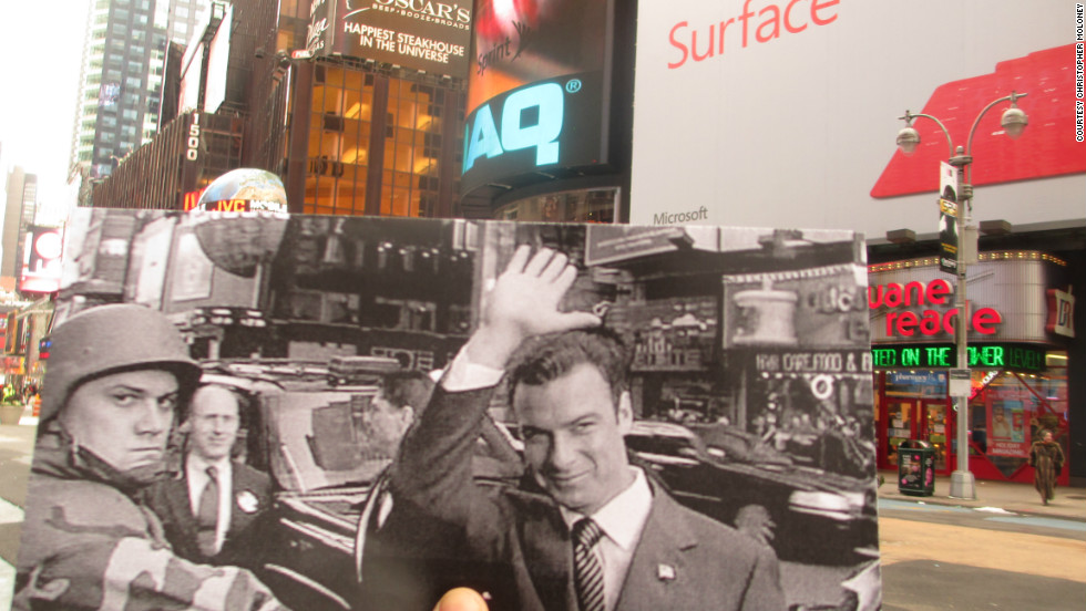 "Rep. Raymond Shaw (Liev Schreiber) waves to supporters as he seeks the vice presidency. Fans of psychological thrillers will recognize the corner he's standing on -- Broadway and 43rd Street -- as the corner Tom Cruise runs past in the movie ""Vanilla Sky."""