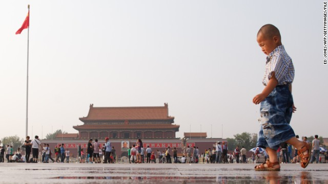 A young boy plays in Tiananmen Square in Beijing on June 3, 2012.