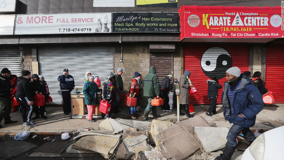 Residents wait in line to collect free gasoline the day after the nor'easter in the Rockaway neighborhood in Queens.
