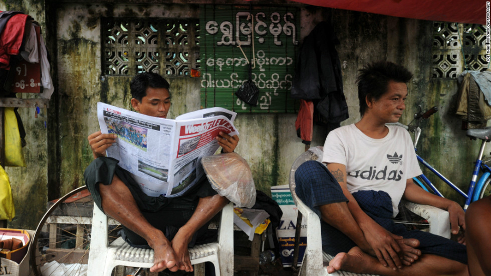 A  man reads a local newspaper after the government announced it had abolished media censorship on August 20, in the latest of a series of rapid democratic reforms, delighting journalists who lived for decades under the shadow of the censors.