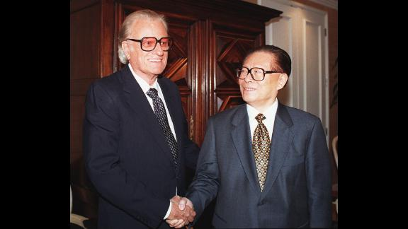 Graham greets Chinese President Jiang Zemin at a California luncheon in 1997.