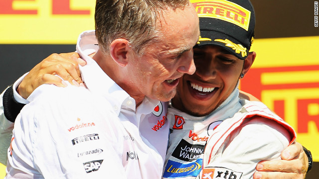 Happier times: Martin Whitmarsh (left) celebrates with Lewis Hamilton after he won this season's Canadian Grand Prix.