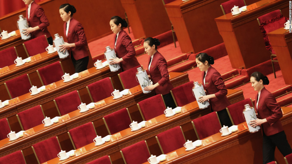 Attendants serve tea during the 18th Communist Party Congress.