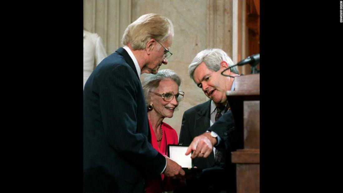 In 1996, House Speaker Newt Gingrich presents Graham with a Congressional Gold Medal during a ceremony on Capitol Hill.