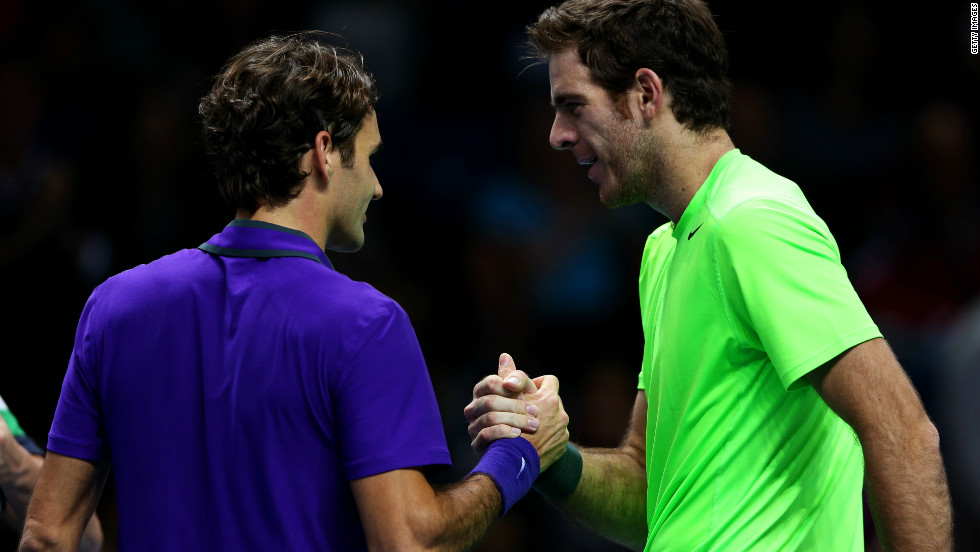 Juan Martin Del Potro, right, shakes hands with Roger Federer after qualifying for the semifinals of the  ATP World Tour Finals with victory over the 17-time grand slam champion.