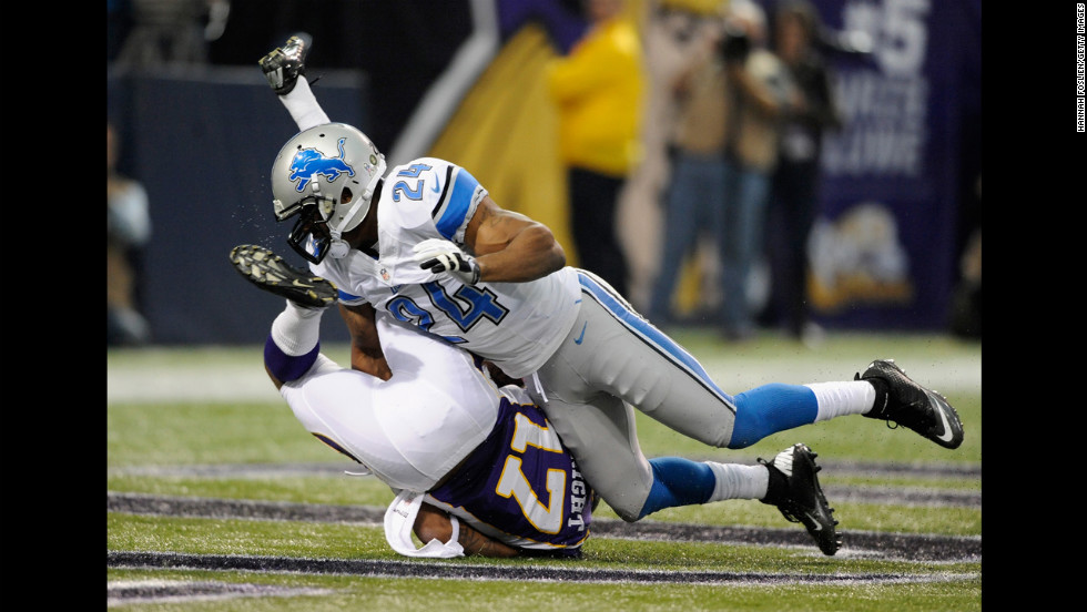 Erik Coleman of the Lions brings down Jarius Wright of the Vikings during the first quarter of Sunday's game.