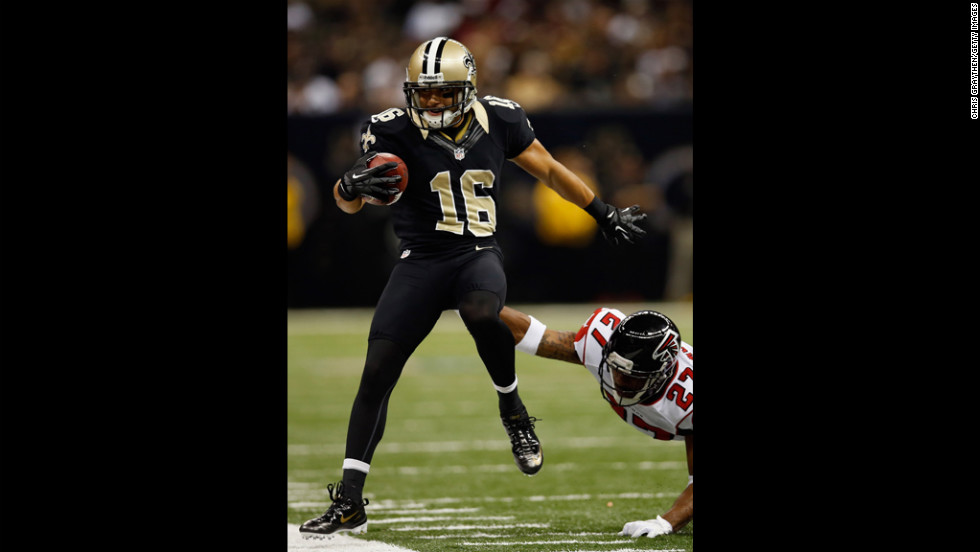 Lance Moore of the Saints is pushed out of bounds by Robert McClain of the Falcons on Sunday.