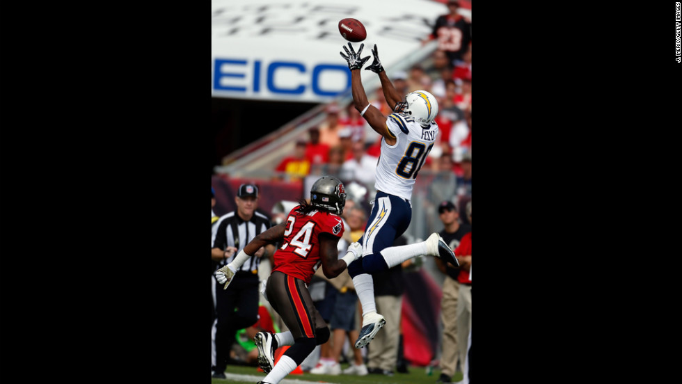 San Diego receiver Malcom Floyd of the San Diego Chargers catches a pass in front of Tampa Bay safety Mark Barron during the game at Raymond James Stadium on Sunday in Tampa, Florida.