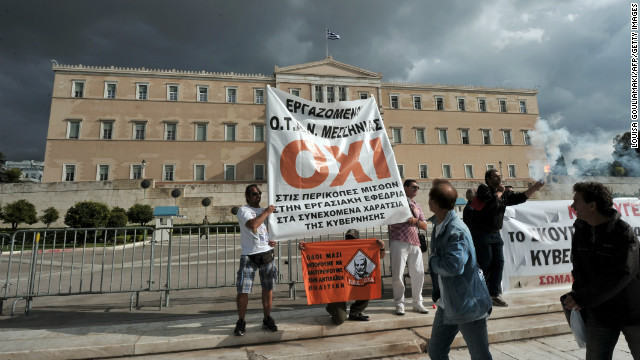 Workers demonstrate against new austerity measures outside the parliament in Athens, Greece on November 10.