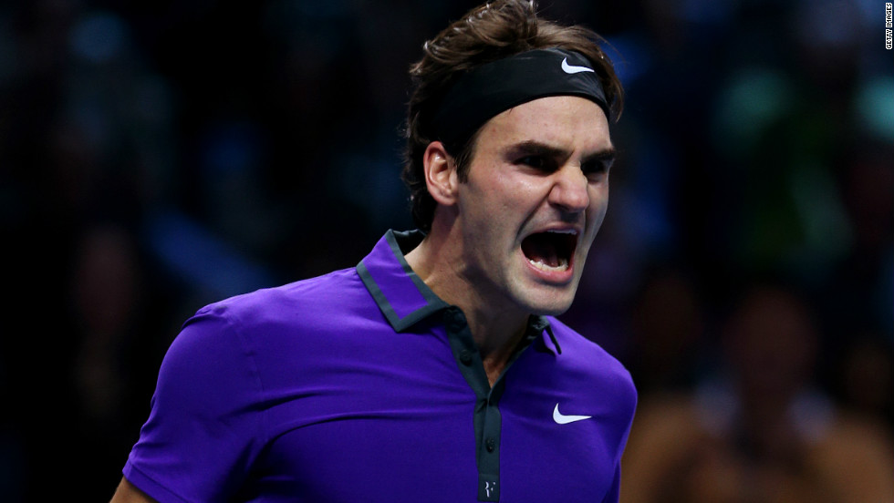 Defending champion Roger Federer celebrates after beating home hope Andy Murray at the ATP World Tour Finals on Sunday.