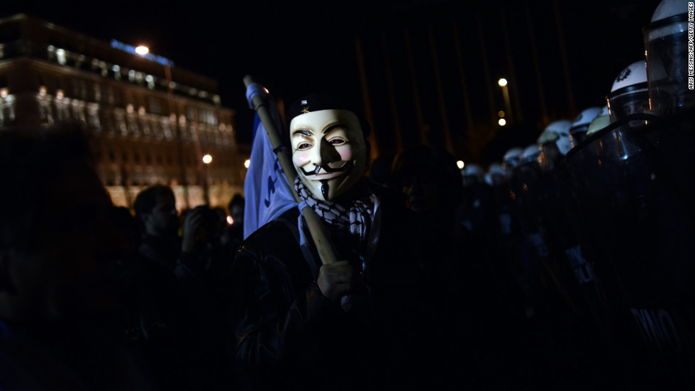 Protesters demonstrate outside the Greek parliament against the new austerity measures in Athens on November 11, 2012.