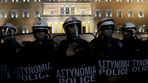 Riot police guard the Parliament building during a demonstration against austerity measures as Greek deputies consider a budget vote on November 11, 2012.