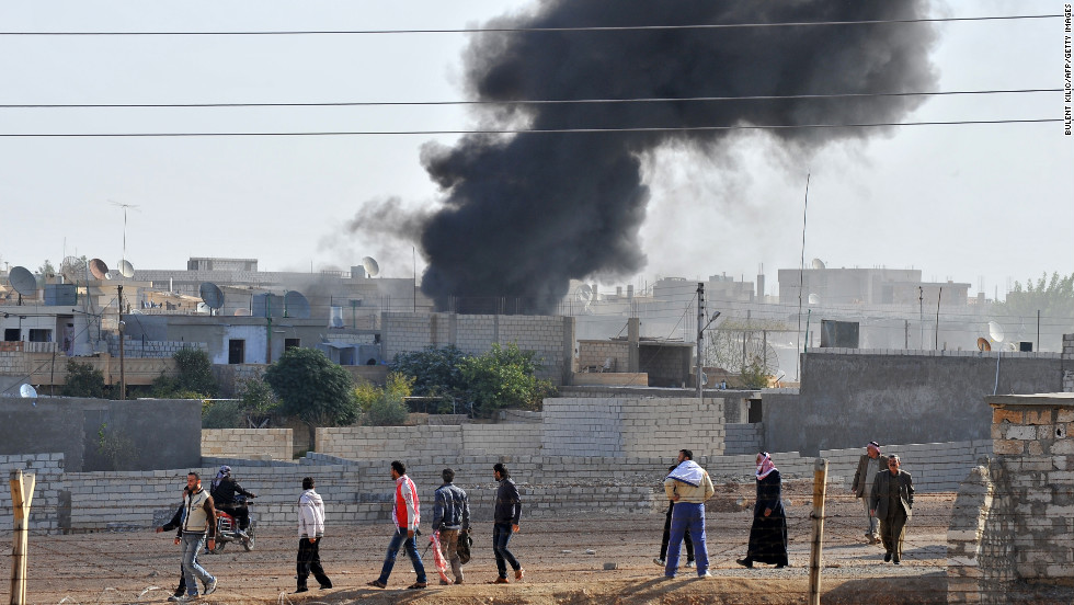 Smoke rises after Syrian aircraft bombed the strategic border town of Ras al-Ain, killing at least four people, wounding many others and sending panicked residents fleeing across to Turkey on Monday, November 12.