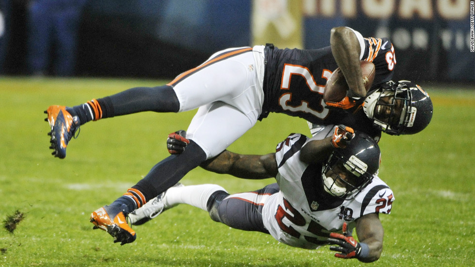 Devin Hester of the Bears is tackled by Kareem Jackson of the Texans on Sunday.