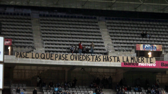 "Oviedo fans display a banner in the Estadio Carlos Tartiere reading: ""Happen what may, Oviedistas until death."" Of Slim"