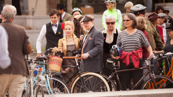 People gather in downtown Decatur before setting off to ride, including Jae Schmidt, pictured with hat, the owner of Houndstooth Road bicycle boutique, who helped organize the event.