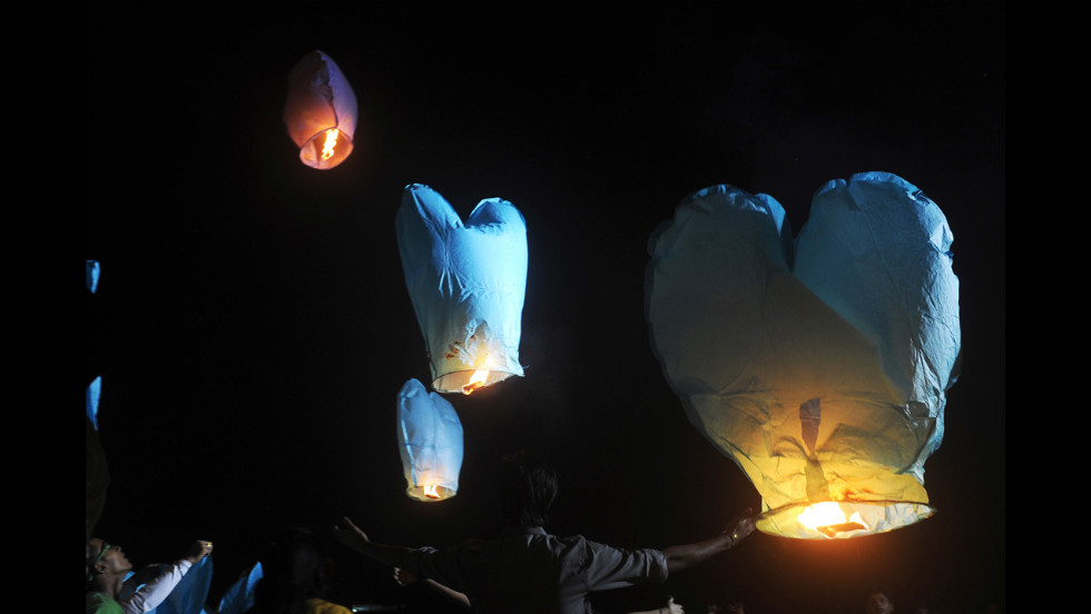 Activists release sky lanterns to promote a peaceful and eco-friendly Diwali and create awareness of child labor in the fire cracker industry during a function in Kolkata, India, on Friday, November 9.