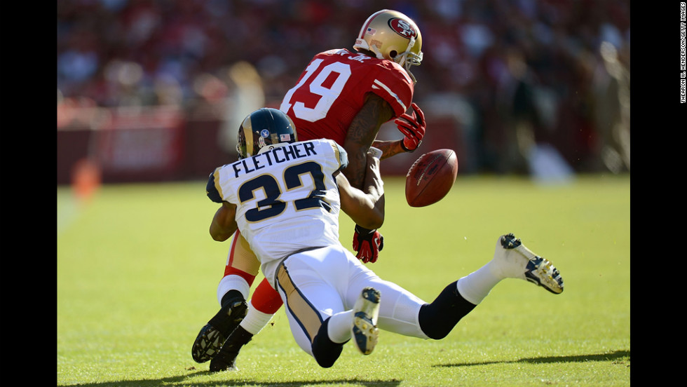 Ted Ginn Jr. of the 49ers, returning a kickoff, has the ball stripped away by Bradley Fletcher of the Rams during the first quarter on Sunday.