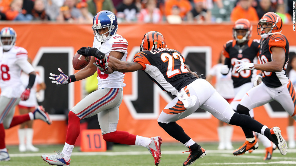 Victor Cruz of the New York Giants drops the ball while defended by Nate Clements of the Cincinnati Bengals at Paul Brown Stadium on Sunday in Cincinnati.