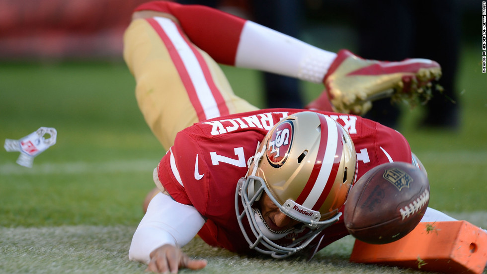 Colin Kaepernick of the San Francisco 49ers dives for the flag and scores on a seven-yard touchdown run against the St. Louis Rams in the fourth quarter at Candlestick Park on Sunday in San Francisco. The game ended after sudden death overtime in a 24-24 tie.