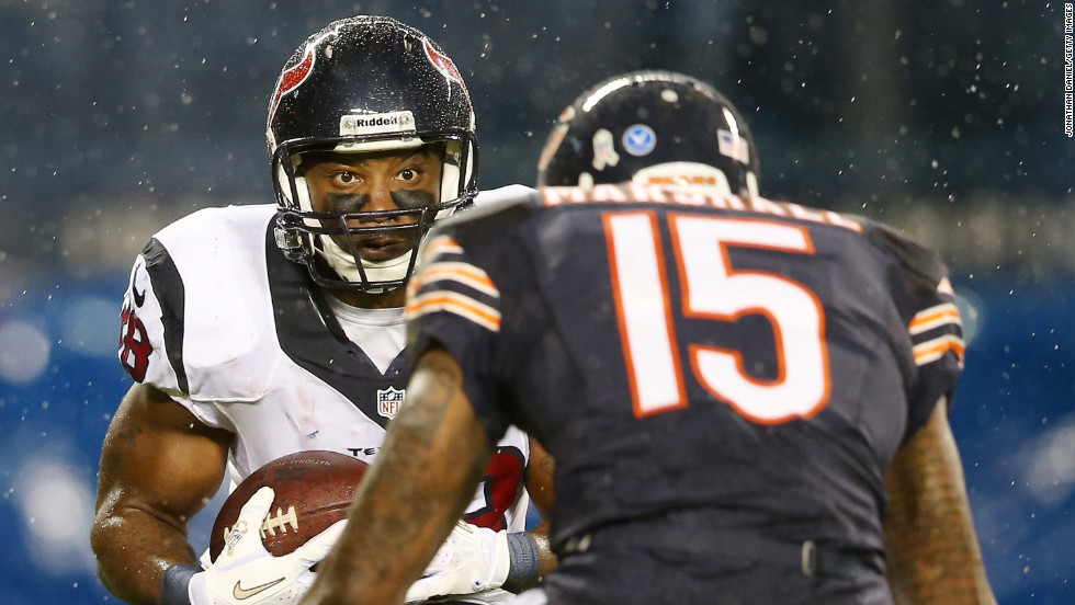 Free safety Danieal Manning of the Houston Texans carries the ball against wide receiver Brandon Marshall of the Chicago Bears at Soldier Field on Sunday in Chicago.