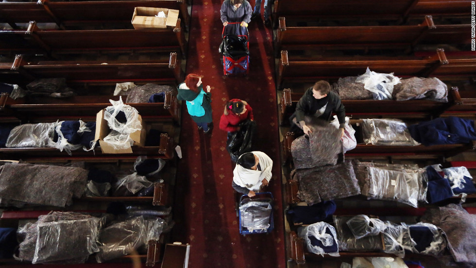 People line up to receive donated items from Catholic Charities of Brooklyn and Queens at Visitation of the Blessed Virgin Mary Catholic Church in Brooklyn on Monday.