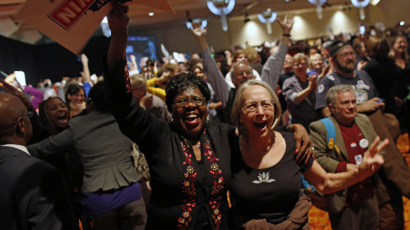 Supporters cheer after President Obama