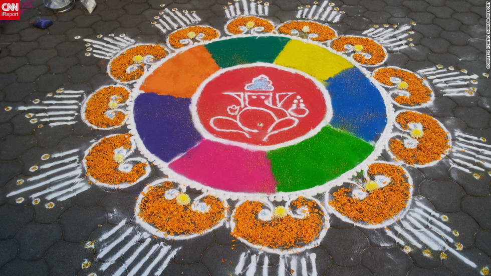 "A rangoli artwork, as created and captured by iReporter <a href=""http://ireport.cnn.com/people/indtechieguy"">Kshitij Sharma</a>, adorns a sidewalk in Pune, India. ""I think this festival reminds us to stay away from bad things and to promote communal harmony,"" he says. ""The main highlight is of course the lights, at night whole cities and towns look lovely because of the lights."""