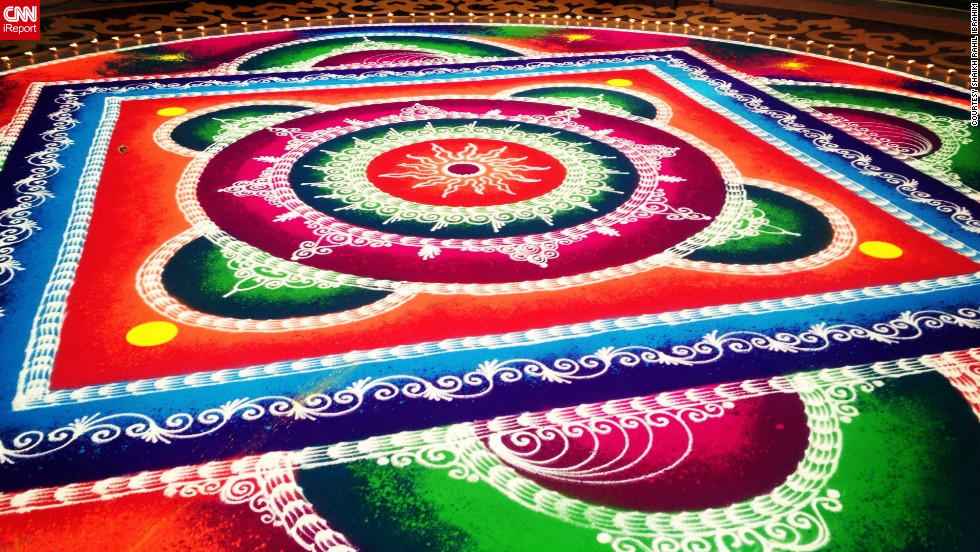 "This photo from instagrammer <a href=""http://statigr.am/viewer.php#/user/26948557/"" target=""_blank"">Shaikh Rahil Ibrahim</a> shows a large colorful rangoli in a shopping mall in Mumbai, India. Rangoli artworks are a common site outside Indian homes and in public spaces throughout Diwali."