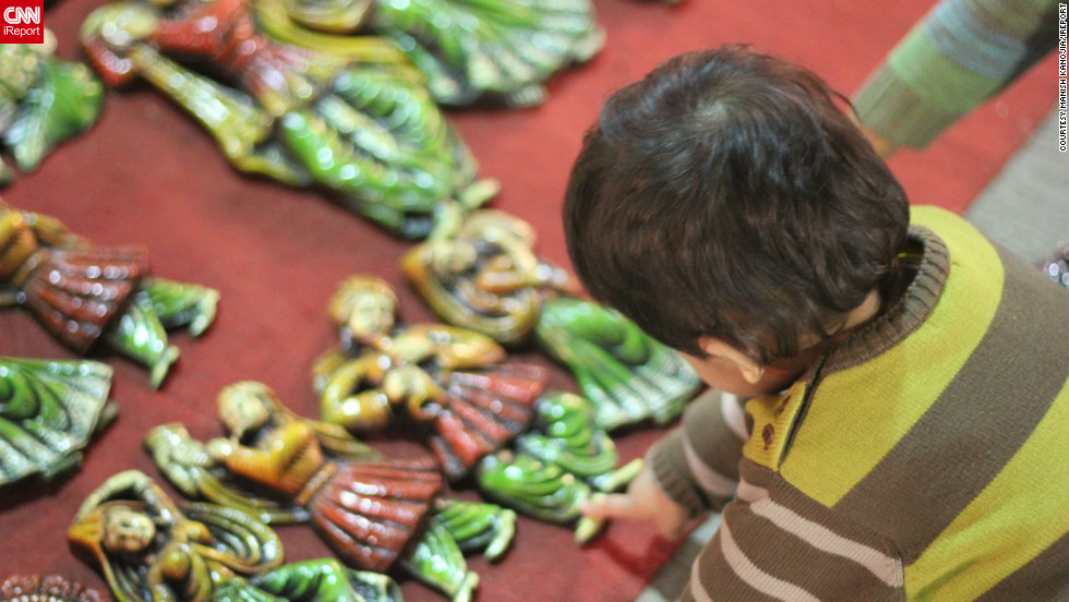 "<a href=""http://ireport.cnn.com/people/manishkanoji"">Manish Kanojia</a> took this image of his daughter, Kyra, reaching out to touch ceramic artifacts on sale at a market in New Delhi, India. The ornamental items are a popular buy around Diwali time when ""people use them to decorate their homes,"" he says."