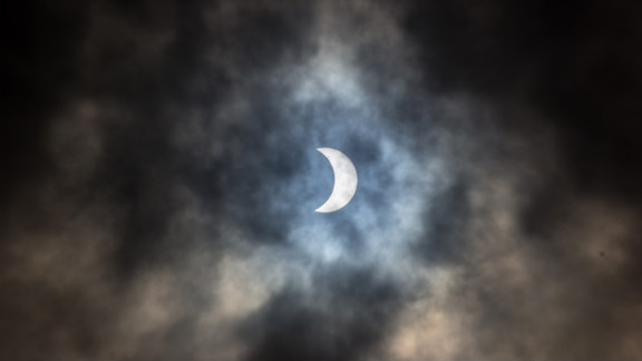 """""""You see the images on the news and in the papers but I think that by the time something has gone to print the impact is lost to a degree, it's different being 'present' for the eclipse. It's [awe-inspiring],"""" said Samantha J Hughes from Auckland, New Zealand."""