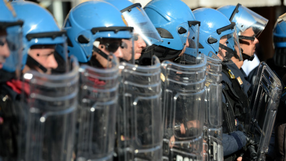 Riot policemen stand in line during a protest against austerity measures by workers in Europe on November 14, 2012 in Rome.