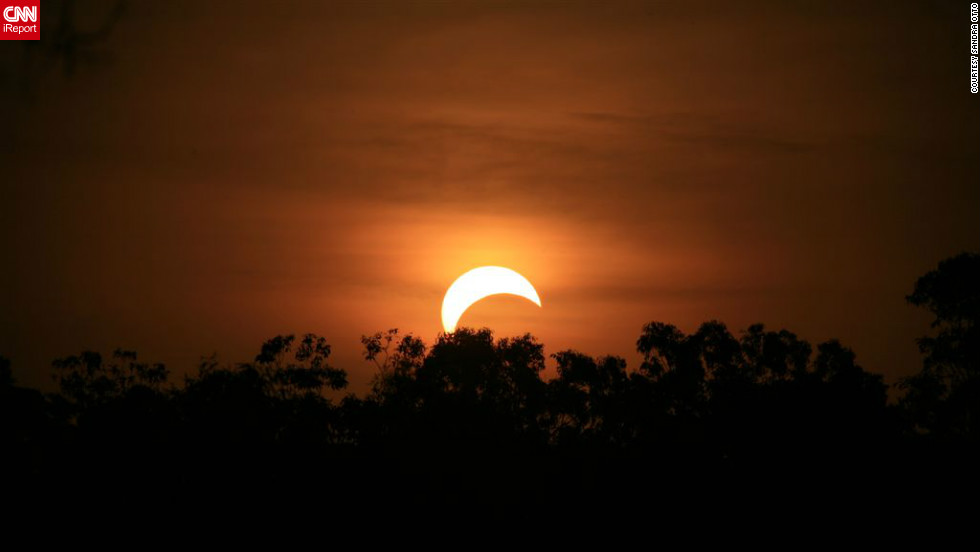 "<a href=""http://ireport.cnn.com/people/Stitchum"">Sandra Otto</a> took this photo from the side of the road in the northern suburbs of Darwin, Australia, after forgetting about the eclipse until it was about to happen. ""I quickly got my camera and my bigger lens and jumped into my utility,"" she says. "" I wish I was better prepared but found it to be a truly amazing experience, spectacular."""