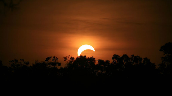 """Sandra Otto took this photo from the side of the road in the northern suburbs of Darwin, Australia, after forgetting about the eclipse until it was about to happen. """"I quickly got my camera and my bigger lens and jumped into my utility,"""" she says. """" I wish I was better prepared but found it to be a truly amazing experience, spectacular."""""""