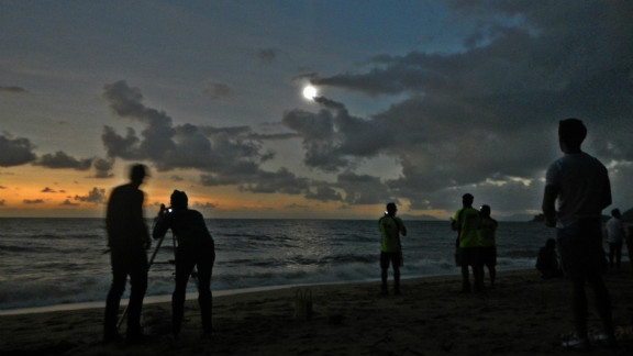 """iReporter David Brungger was one of many people to witness the eclipse at Palm Cove in the north of Queensland. """"When everything finally went almost totally dark, some people were clapping, some people were cheering with joy, and we all took our eclipse glasses off to enjoy some of the most exciting and beautiful seconds of my life. Too bad it only lasted roughly one minute,"""" he says."""