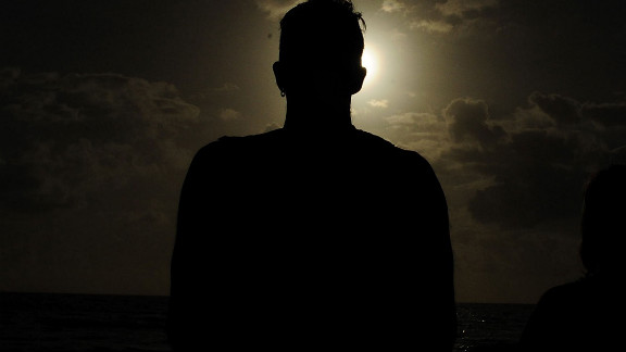 A spectator views the solar eclipse on Wednesday in Palm Cove.