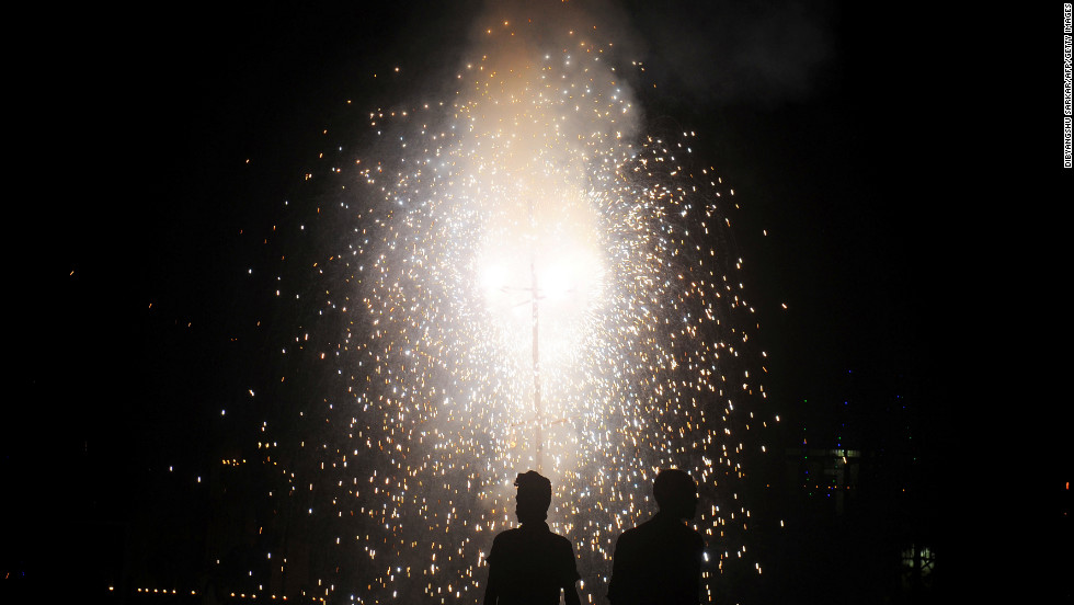 Revelers watch fireworks at a park during Diwali in Kolkata, India, on Tuesday.