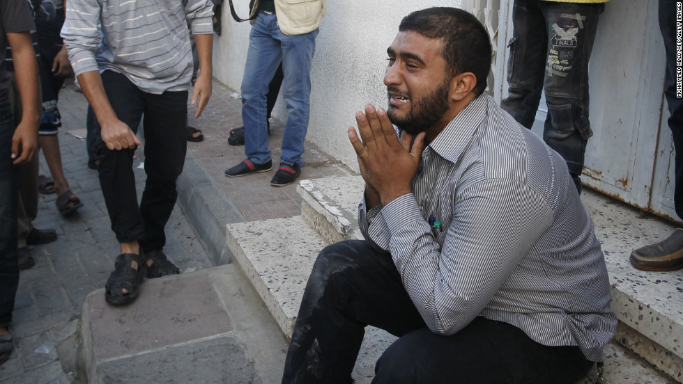 A Palestinian man cries as security forces wheel al-Jaabari's body into a hospital.