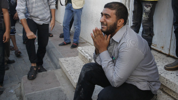 A Palestinian man cries as security forces wheel al-Jaabari