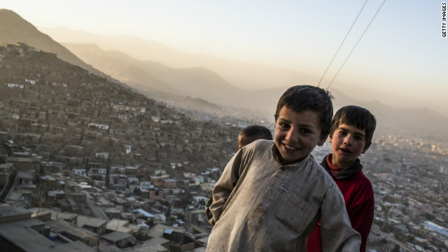 Afghan children play in the outskirts of Kabul on November 11, 2012.