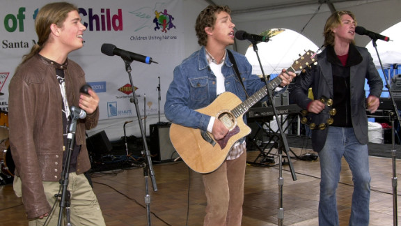 "Isaac, Taylor and Zac Hanson of Hanson perform in 2001. The brothers became superstars with their 1997 album ""Middle of Nowhere"" thanks to a little earworm called ""MMMBop."""