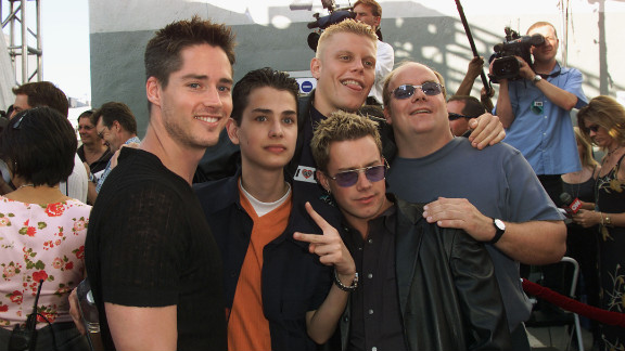 "The made-for-TV boy band 2gether debuted on MTV in 2000. Shown here at the 2000 MTV Movie Awards, the guys attracted attention with songs like ""U + Me = Us (Calculus)"" and ""Say It (Don't Spray It)."" ""2ge+her: The Series"" followed the original TV movie, but ended in 2001 when member Michael Cuccione died of cancer. In November 2011, Alex Solowitz, Evan Farmer, Noah Bastian and Kevin Farley said they were looking to reunite the band."