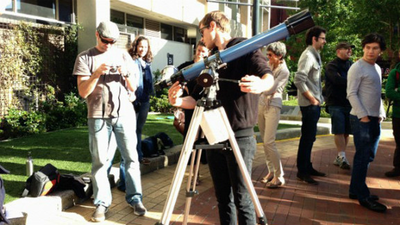 """Staff and students used the campus at Swinburne University in Melbourne, Australia, to hook up telescopes and camera equipment to capture the eclipse, says Kim Tairi. """"We have a center for astrophysics and supercomputing here ... [so we] set up an area on campus [where] people could come past and get a look at the eclipse,"""" she says."""