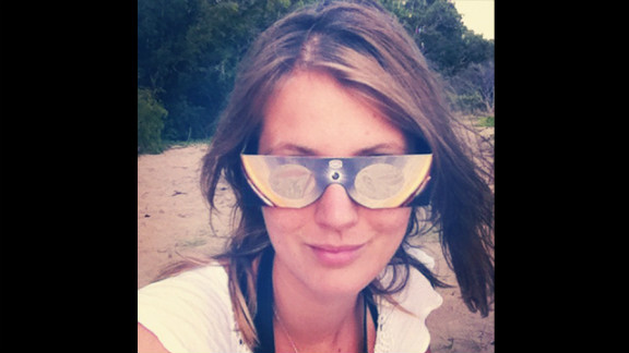 """Instagrammer Tawnymc had style and concept covered with these chic glasses as she settled in to watch the eclipse from Buchanon Beach near Cairns. """"(They) were amazing, we could see the moon move across the sun and we shared them around the beach - they were just $10 too,"""" she says."""