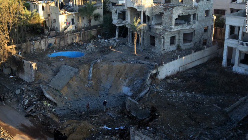 A crater is left at a spot targeted by an Israeli airstrike in Gaza City early Thursday, November 15.