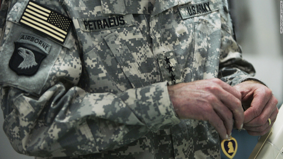 Gen. David Petraeus was promoted to commander of all U.S. forces in Iraq in February 2007. Pictured, Petraeus awards Purple Hearts to a wounded soldiers at the 28th Combat Support Hospital in March 2007 in Baghdad, Iraq.