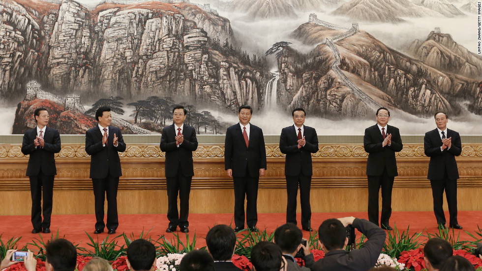 From left, Zhang Gaoli, Liu Yunshan, Zhang Dejiang, Xi Jinping, Li Keqiang, Yu Zhengsheng and Wang Qishan greet the media at the Great Hall of the People on November 15.  China's ruling Communist Party revealed the new Politburo Standing Committee after its 18th congress.