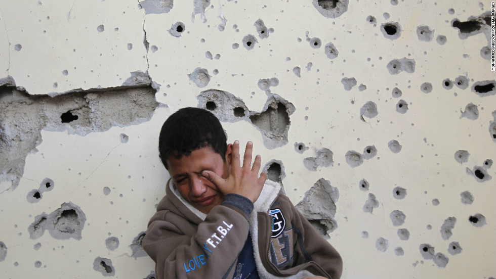 Palestinian Fares Sadallah, 11, cries outside his home after an Israeli airstrike Friday, November 16, in northern Gaza.