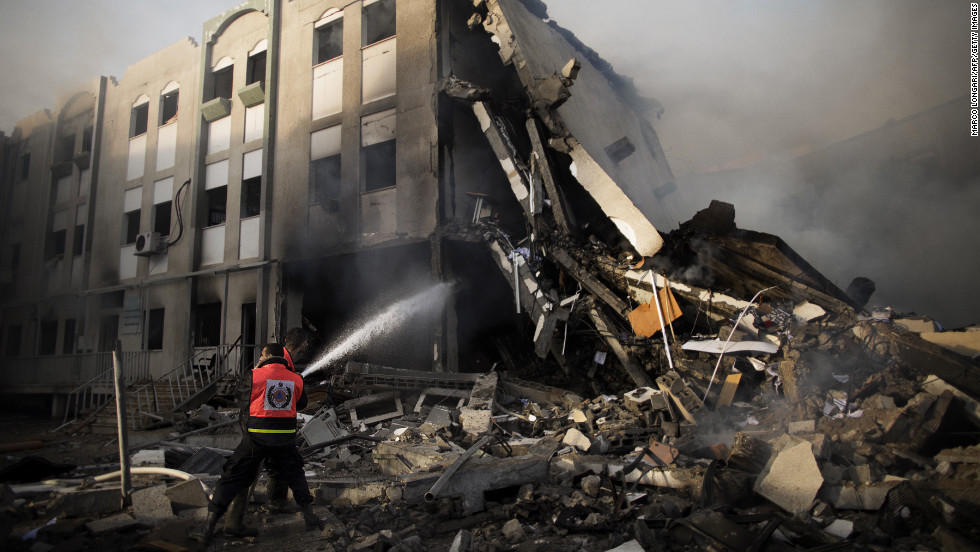 Palestinian firefighters try to extinguish a blaze Friday, November 16, at the Ministry of Interior in Gaza City following an Israeli air raid.