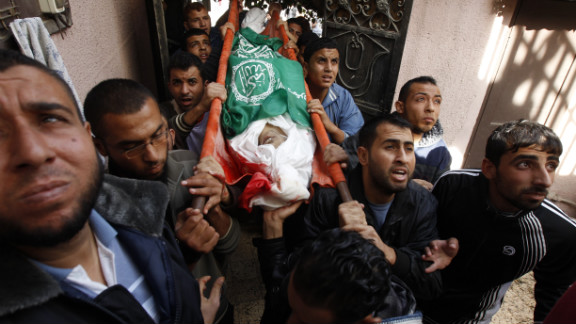 Palestinian mourners carry the body of Audi Naser during his funeral in Gaza on Friday, November 16.